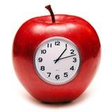 吃食物的苹果时钟健康 免版税库存照片