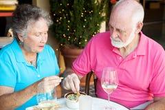 吃饭的客人高级严重 免版税图库摄影