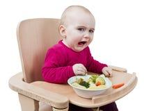 吃高年轻人的椅子子项 库存照片