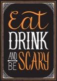吃,饮料并且是可怕万圣夜背景 免版税库存图片