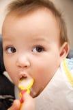 吃婴孩 免版税库存照片