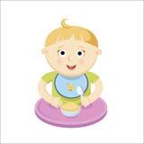 吃porrige的小婴孩 库存图片