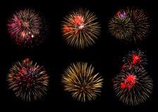 各种各样的五颜六色的烟花的汇集在黑背景的 免版税库存照片