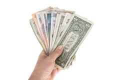 各种各样的国家钞票爱好者在手上 免版税库存照片