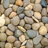 各种各样的小卵石向纹理扔石头 图库摄影