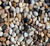各种各样的小卵石向纹理扔石头 库存图片
