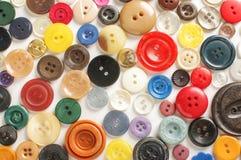 各种各样的按钮的汇集在明亮的背景的 图库摄影