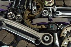 各种各样的汽车零件和工具 免版税库存照片