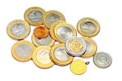 各种各样的硬币和金子 免版税库存图片