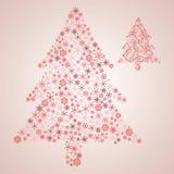 从各种各样的红色雪花的圣诞树 免版税库存照片