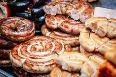 各种各样的肉纤巧,自创香肠 免版税库存照片
