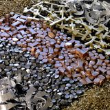 各种各样的金属后面 免版税库存图片