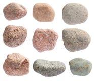 各种各样的颜色河石头在白色被隔绝 免版税库存照片