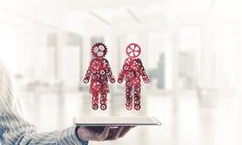 合作的概念或可能家庭与两个图presenti 免版税库存图片