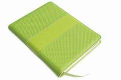 黏合剂笔记本绿色皮革盖子  免版税库存图片