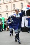 合奏Imamat (太阳达吉斯坦)的独奏者舞蹈家表现与北高加索的传统舞蹈的 库存照片
