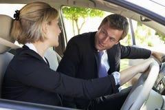 合并旅途的两个企业同事汽车入工作 免版税库存图片
