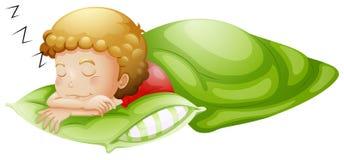 合理地睡觉一个的小男孩 库存图片