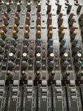 合理的控制器滑子在录音室 库存照片