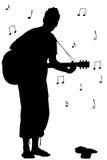 吉他人剪影 免版税库存图片