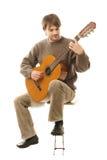 吉他吉他弹奏者使用 免版税图库摄影