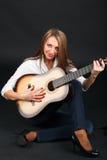 吉他妇女 免版税库存照片