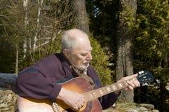 吉他弹奏者前辈 免版税库存图片