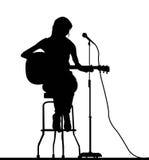 吉他弹奏者妇女 免版税库存图片