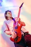 吉他弹奏者岩石 库存图片