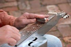 吉他演奏员钢 库存照片