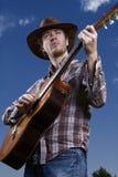 吉他演奏员青年时期 免版税库存照片
