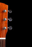 吉他脖子顶层在黑色背景的 库存照片
