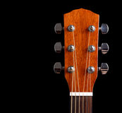 吉他脖子顶层在黑色背景的 库存图片