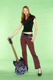 吉他顶头球员红色岩石卷 免版税库存照片