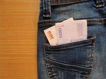 吉恩口袋和金钱 免版税库存照片