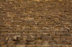 吉萨金字塔的巨型的石头 图库摄影