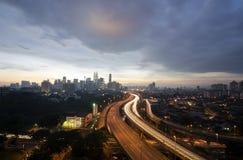 吉隆坡市日落地平线有双峰塔的或 免版税库存图片