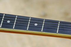 吉他串和苦恼板 免版税库存照片
