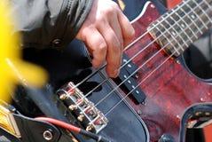 吉他弹奏者戏剧 库存照片