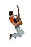 吉他演奏员跳跃 免版税图库摄影