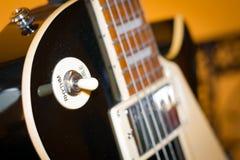 黑吉他特写镜头 库存照片