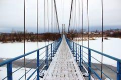 吊桥在冬天 免版税库存图片