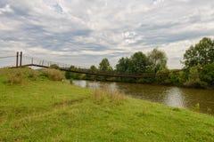 吊桥通过一条小河 库存图片