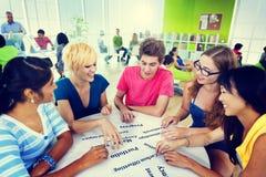 同事不同的学生配合工友概念 免版税库存图片