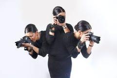 同时拍摄多射击的妇女 免版税库存照片