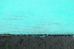 同色而浓淡不同的木背景包括的绿松石颜色和黑色 免版税库存照片