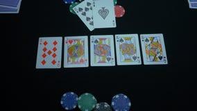 同花大顺的细节在黑背景的 锹同花大顺在扑克牌游戏的在黑背景 球员收集 图库摄影
