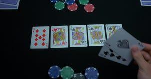 同花大顺的细节在黑背景的 锹同花大顺在扑克牌游戏的在黑背景 球员收集 影视素材