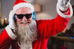 同dj比赛的圣诞老人 库存照片