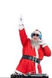 同dj比赛的圣诞老人 免版税库存照片